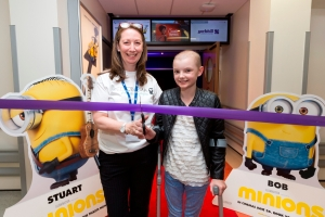 GLASGOW, UK. 03/08/2015 L to R: Sheila Hay-Pacifico (Yorkhill Medicinema manager) & Rachael Proctor (patient, 11 yrs old from Balloch) open the new Medicinema supported by Yorkhill Children's Charity at The Royal Hospital For Children. in Glasgow. COPYRIGHT © STUART WALLACE 2015 visit my website: www.stuartwallacepictures.com