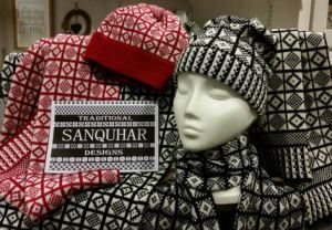 The distinctive 2-colour geometric Sanquar knitting pattern.