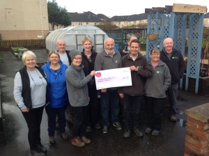 Shettleston Community Growing Project volunteers with their giant cheque