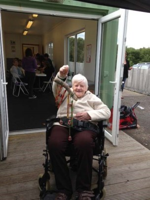 Woman in wheelchair taking part in activities at Belville Community Garden Trust