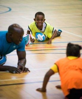 Children and volunteer doing exercises on the floor