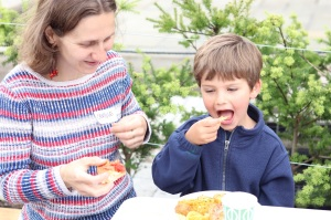A mother and son enjoying some tasty food