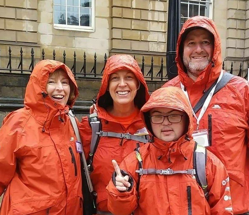 Volunteers with raincoats on