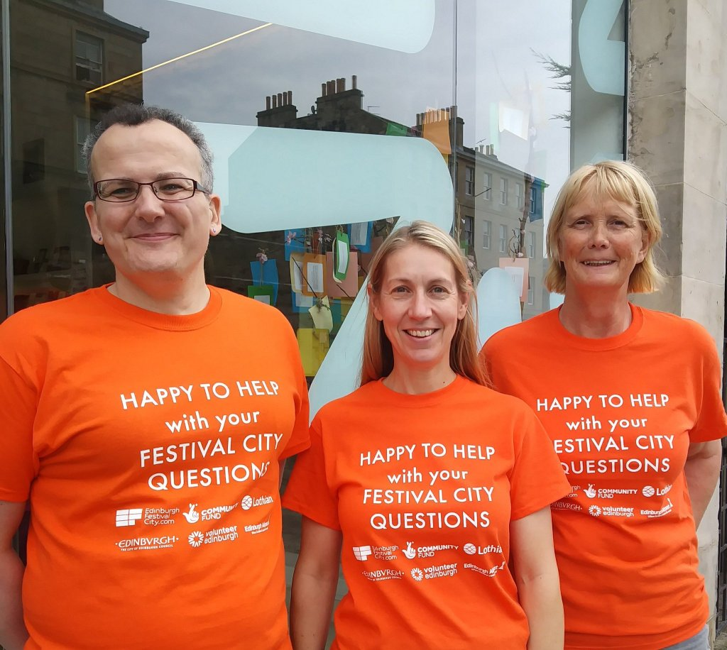 Volunteers together with orange tshirts