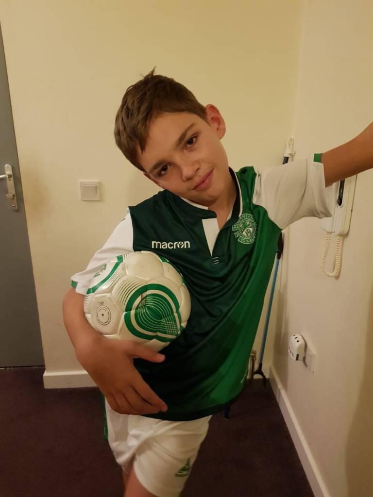 Nathan holding a Hibernian football