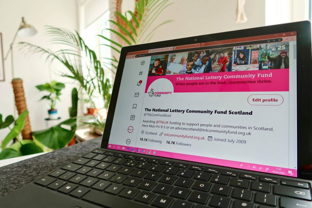 laptop with a screenshot of The National Lottery Community Fund Scotland's social media page