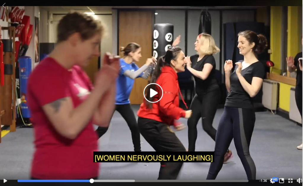 An example of video with captions which reads 'Women Nervously Laughing'