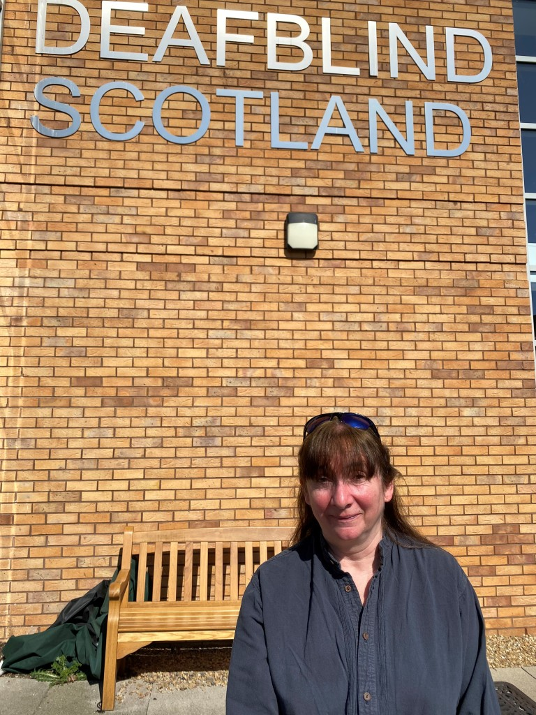 Issy outside Deafblind Scotland's Learning and Development centre